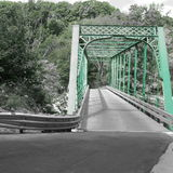 Back road green bridge. Greyscale bridge highlighted with green showing Royalty Free Stock Photos
