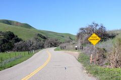 Back road here we come.. Back road with road narrow sign royalty free stock photo