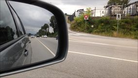 Back road reflected in car mirror Stock Image