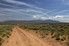 Back Road to Moab Utah. Four wheel drive trail across the desert to Moab Utah with the La Sal Mountains in the distance Royalty Free Stock Images