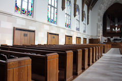 Back of rows of church pews Royalty Free Stock Photos