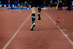 Back running on track jumper athlete Royalty Free Stock Photography