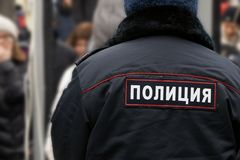 Back of a russian policeman wearing an uniform with an emblem. On work royalty free stock photos