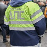 Back of a russian traffic policeman wearing his uniform jacket. With an emblem and reflective strips outdoors stock images