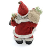 Back of Santa Claus. Santa Claus doll from the back. Isolated on a white background royalty free stock image