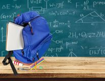 Colorful school supplies in backpack on wooden. Back school backpack back to school art objects school background color Stock Photo