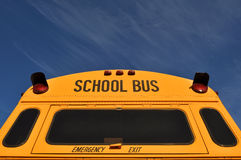 Back of School Bus with Blue Sky Stock Photo