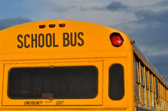 Back of School Bus with Cloudy Sky Royalty Free Stock Photography