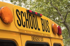 Back of school bus with a sign Stock Photos
