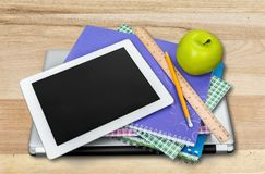 School supplies with tablet and laptop on stock image