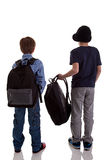 Back of schoolboy holding backpack Royalty Free Stock Photos