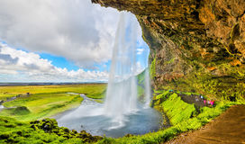 At the back of Seljalandsfoss waterfall - Iceland Stock Photography