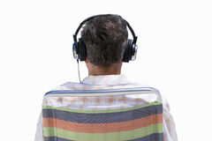 back of senior man's head wearing earphones, cut out Royalty Free Stock Images