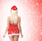 Back of a sexy blond woman in Santa lingerie on snow Stock Photo
