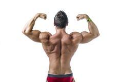 Back of shirtless muscular man, standing in studio shot Stock Photo