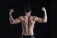 Back of shirtless muscular young man doing double Royalty Free Stock Image