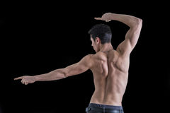 Back of shirtless muscular young man doing dynamic Stock Photography