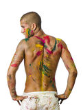 Back of shirtless young man, skin painted all over with bright Holi colors. Handsome young man seen from the back with skin all painted with Holi colors Stock Photography