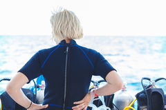 Back side of calm diver woman Royalty Free Stock Photo