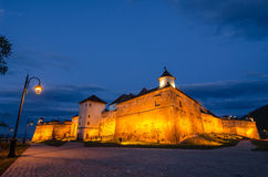 Back side of the Citadel of Brasov at twilight, landmark of Brasov Royalty Free Stock Image