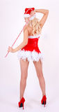 Back side of dancing Santa girl with candy cane stick on white Stock Images