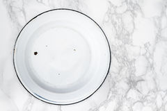 Back Side of Empty White Vintage Enamel Plates on Marble Royalty Free Stock Image