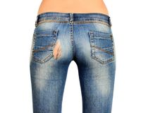 The back side of the female in torn blue jeans isolated stock photography