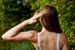 Back side of the female outdoors in summer time Royalty Free Stock Photo