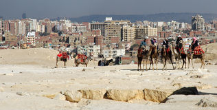 The Back Side of Giza. Looking toward Cairo from the Pyramids of Cairo. Photo shows encroachment of city upon the Giza site, which many tourists feel is in the ' royalty free stock photo