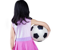 Back side of little girl holding a ball Royalty Free Stock Photo