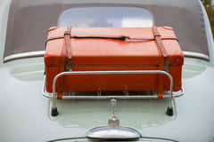 Back side luggage on classic car. Vintage car with suitcase on back side Stock Photo