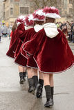 Back side of majorettes in purple cloak at Carnival parade, Stut Royalty Free Stock Photo