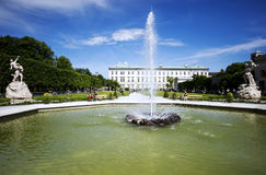 Back side of the Mirabell Palace with fountain in Salzburg Royalty Free Stock Photo