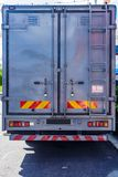 Back side of modern truck standard metal container stock images