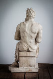 Back side of Moses statue. Moses statue on wooden floor and white background Stock Images