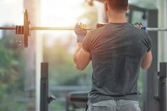 Free Back Side Od Strong Muscular Asian Man Lifting Weights Exercise His Breast In Fitness Gymnasium,sport And Healthy Concept Royalty Free Stock Photography - 158585157