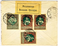 Back side of an old Russian military censored lett. Back of an old yellow WW1 world war one military censored envelope stamped in tsarist Russia, dated 9th of stock images