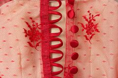 Back side of red flower lace on oval color. stock photo