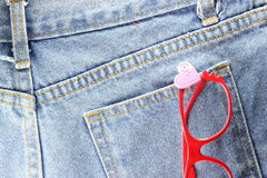 Back side Texture of blue jeans with glasses. Close up back side Texture of blue jeans with glasses Stock Image
