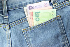 Back side Texture of blue jeans with pockets  money Stock Images