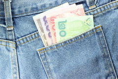 Back side Texture of blue jeans with pockets  money Royalty Free Stock Images