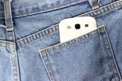 Back side Texture of blue jeans with telephone. Close up back side Texture of blue jeans with telephone Royalty Free Stock Photo