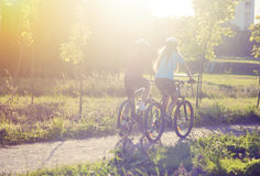 Back side of Two Cycling Athlets Riding Outdoor Stock Photography