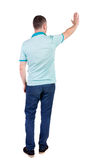 Back side view of man  in shirt handshake. Royalty Free Stock Photography