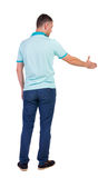 Back side view of man  in shirt handshake. Royalty Free Stock Photo