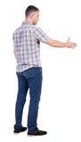 Back side view of man  in shirt handshake. Stock Images