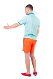 Back side view of man  in shorts handshake. Royalty Free Stock Photos