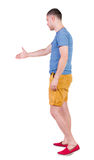 Back side view of man  in shorts handshake. Stock Photo