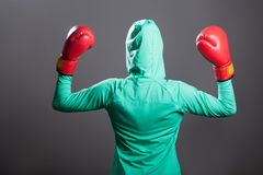 Back side view of muslim boxer woman in green islamic sportswear. Back e view of muslim boxer woman in green islamic sportswear, standing and hiding with covered royalty free stock image