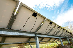 Back side view photovoltaics in solar power station Stock Photos